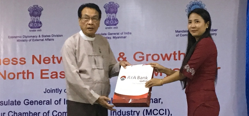 Presentation of Momento to H.E. U Myat Thu, Hon'ble Minister for Planning and Finance, Mandalay Region Government by AYA Bank, Mandalay during the Business Networking and Growth Between North East India and Myanmar on 13th June 2018 at Mandalay Region Chamber of  Commerce and Industry (MRCCI), Mandalay