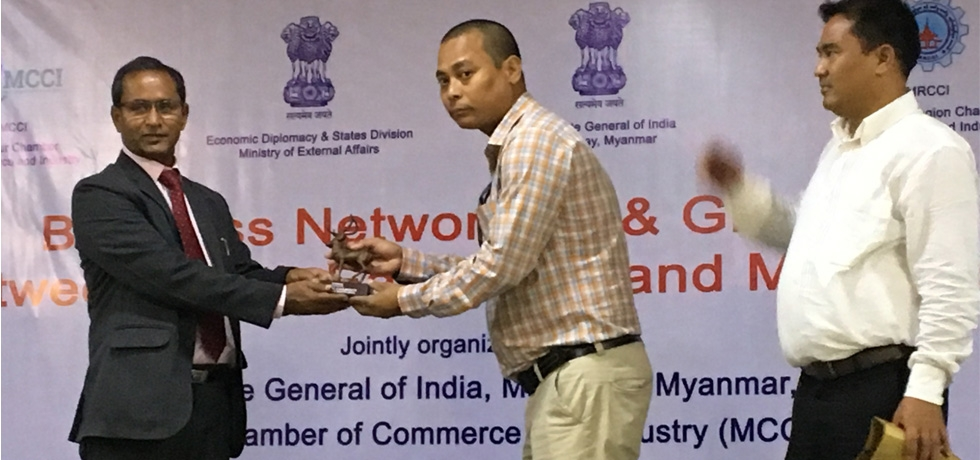 Presentation of Momento to H.E. Mr. Nandan Singh Bhaisora, Consul General of India by the delegate from North East India during the Business Networking and Growth Between North East India and Myanmar on 13th June 2018 at Mandalay Region Chamber of Commerce and Industry  (MRCCI), Mandalay