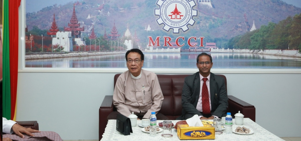 H.E. U Myat Thu, Hon'ble Minister for Planning and Finance, Mandalay Region Government with H.E. Mr. Nandan Singh Bhaisora, Consul General of India, Mandalay during Business Networking and Growth Between North East India and Myanmar on 13th June 2018 at Mandalay Region  Chamber of Commerce and Industry (MRCCI), Mandalay