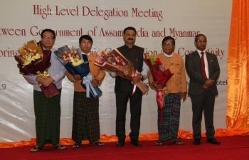 Consul General presenting flower bouquet to H.E. Dr. Zaw Myint Maung, Hon. Chief Minister, Mandalay Region, during  High Level Meeting between Govt of Assam and Myanmar for exploring greater Economic Cooperation and Connectivity.
